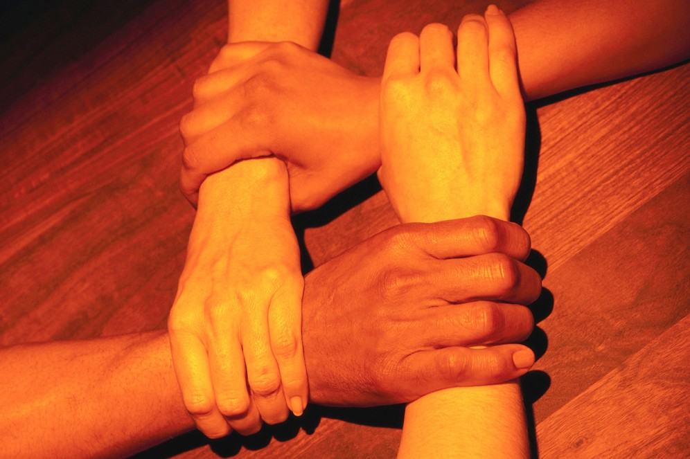 Four Hands Joined Together